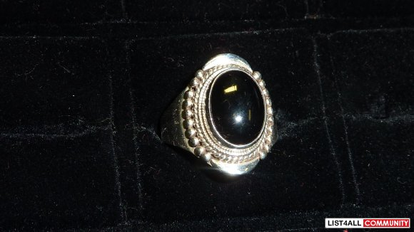 Silver ring, black stone size 11.5