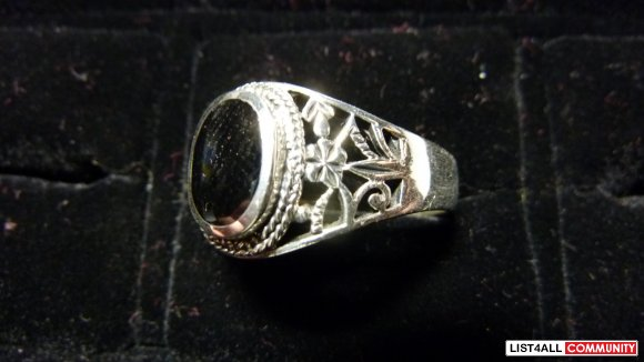 Silver ring, black stone size 13.5
