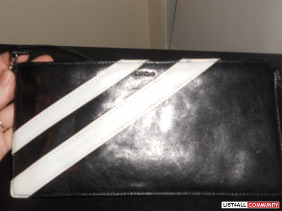 Bebe black clutch with white stripes