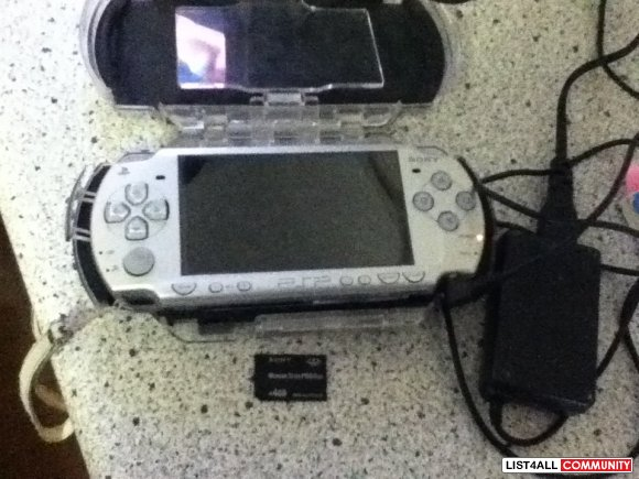 PSP 2000 Silver with a case, charger, 4GB Memory Stick