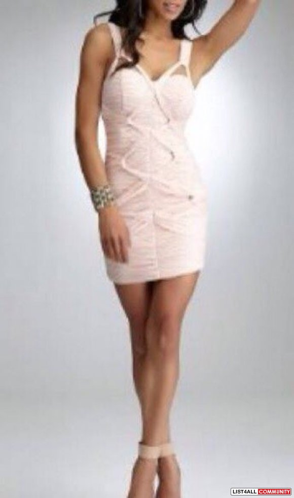 Luxe and sophisticated, this bebe cocktail dress features sexy necklin