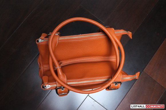 CNKW 100% leather orange handbag