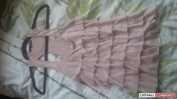 Pink frilly sleeveless top