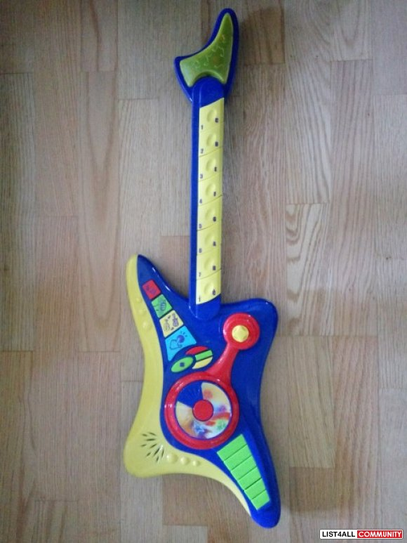 Large Guitar Ages 3-6, 4 AAs required, $24.99 MSRP