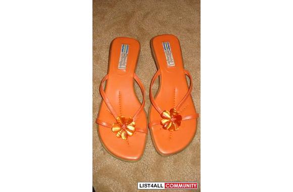 Cute Orange sandal original tag still on with $89.