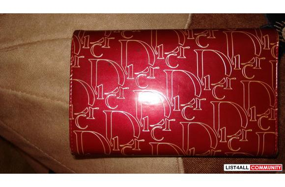 Red Christian Dior wallet with golden Dior all over