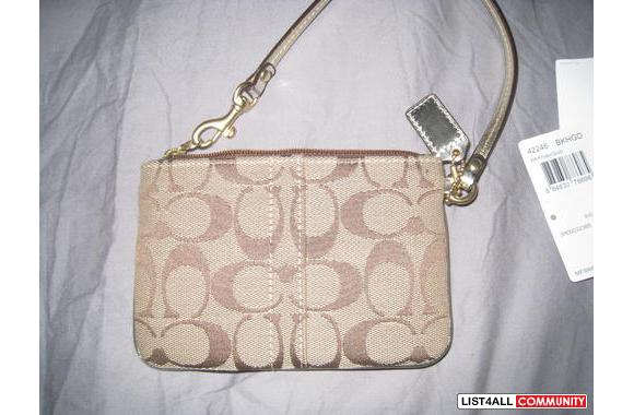 COACH wristlet in Gold w/ Pink interior
