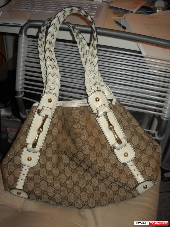 Authentic Gucci leather braided strap purse - $500
