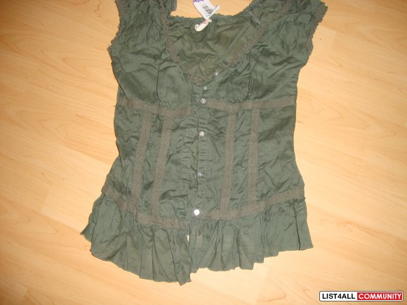 size SMALL fitted low cut green top